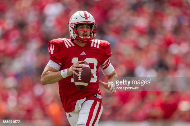 Nebraska Cornhuskers quarterback Tanner Lee rolls out to pass for the red team during Spring Game at Memorial Stadium in Lincoln Nebraska Red 55...