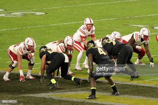 Nebraska Cornhuskers quarterback Tanner Lee takes a snap during the Big Ten conference game between the Purdue Boilermakers and the Nebraska...