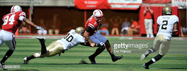 Nebraska Cornhuskers quarterback Taylor Martinez runs from Idaho Vandals safety Shiloh Keo and Idaho Vandals cornerback Kenneth Patten during second...