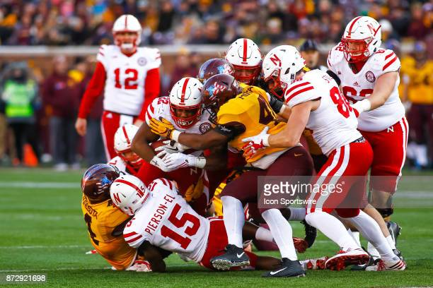 Nebraska Cornhuskers running back Devine Ozigbo is tackled in the 4th quarter during the Big Ten Conference game between the Nebraska Cornhuskers and...