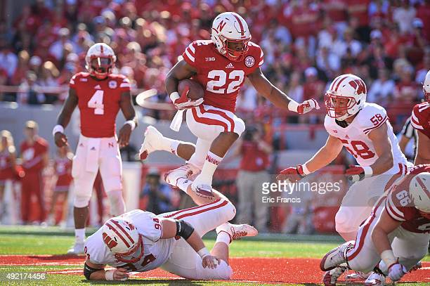 Nebraska Cornhuskers running back Devine Ozigbo leaps over defensive tackle Conor Sheehy of the Wisconsin Badgers during their game at Memorial...