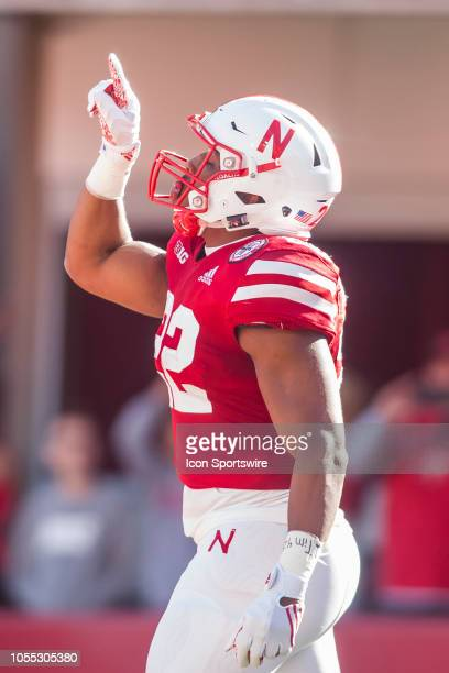 Nebraska Cornhuskers running back Devine Ozigbo signals to his teammates after scoring a touchdown during the game between the BethuneCookman...