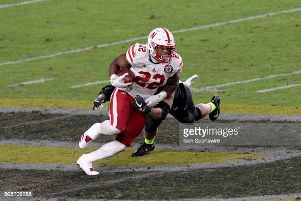Nebraska Cornhuskers running back Devine Ozigbo slips a tackle at midfield during the Big Ten conference game between the Purdue Boilermakers and the...