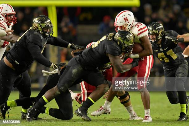 Nebraska Cornhuskers running back Jaylin Bradley is hit by Purdue Boilermakers linebacker Ja'Whaun Bentley during the Big Ten conference game between...