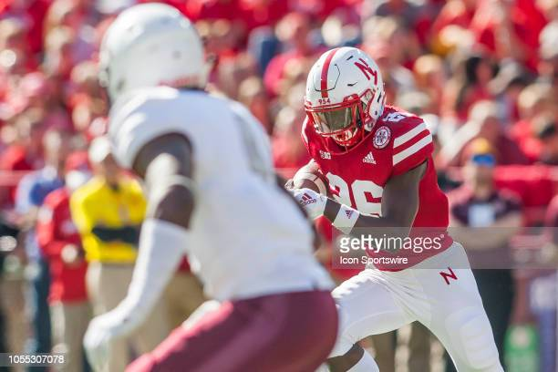Nebraska Cornhuskers running back Miles Jones stares down a would be defender while bringing the ball upfield during the game between the...