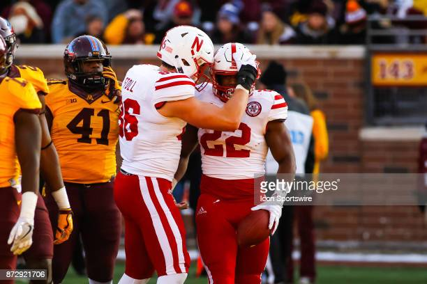 Nebraska Cornhuskers tight end Jack Stoll left celebrates with running back Devine Ozigbo after Ozigbo rushed for a touchdown in the 4th quarter...