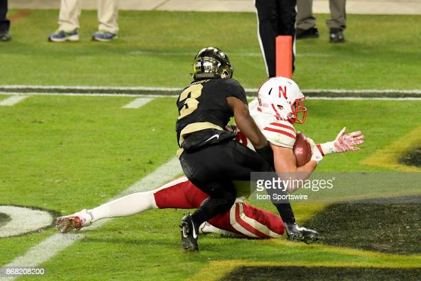 Nebraska Cornhuskers tight end Tyler Hoppes steps into the end zone and is immediately hit by Purdue Boilermakers cornerback Kamal Hardy during the...
