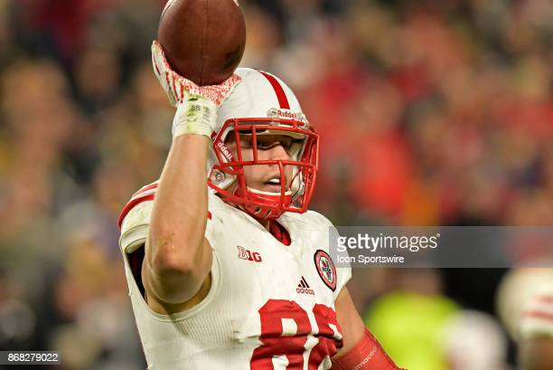 Nebraska Cornhuskers tight end Tyler Hoppes tosses the ball to an official during the Big Ten conference game between the Purdue Boilermakers and the...