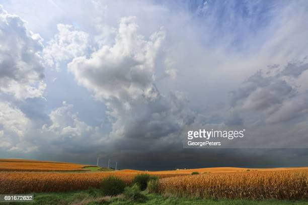 nebraska farm with approaching storm - great plains stock pictures, royalty-free photos & images