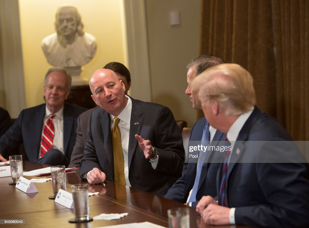 Nebraska Governor Pete Ricketts speaks to U.S. President Donald Trump during a meeting on trade with governors and members of Congress at the White House on April 12, 2018 in Washington, DC.