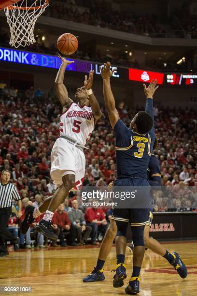 Nebraska guard Glynn Watson Jr makes a lay up against Michigan guard Zavier Simpson during the first half of a college basketball game Thursday...