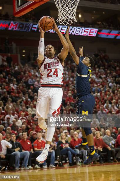Nebraska guard James Palmer Jr makes a lay up against Michigan guard Zavier Simpson during the first half of a college basketball game Thursday...