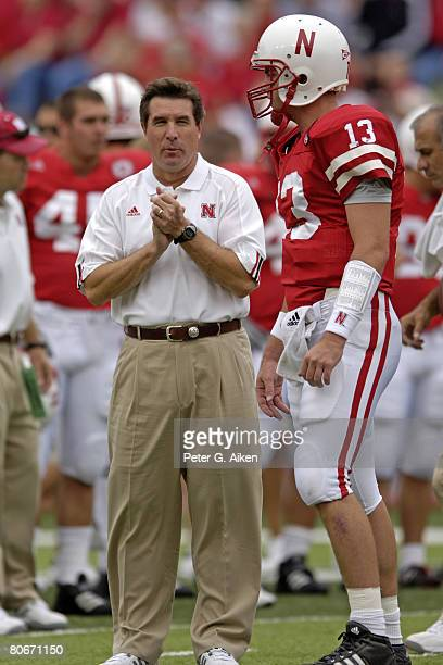 Nebraska head coach Bill Callahan talks with quarterback Zac Taylor before the Huskers take on Pittsburgh at Memorial Stadium in Lincoln Nebraska on...