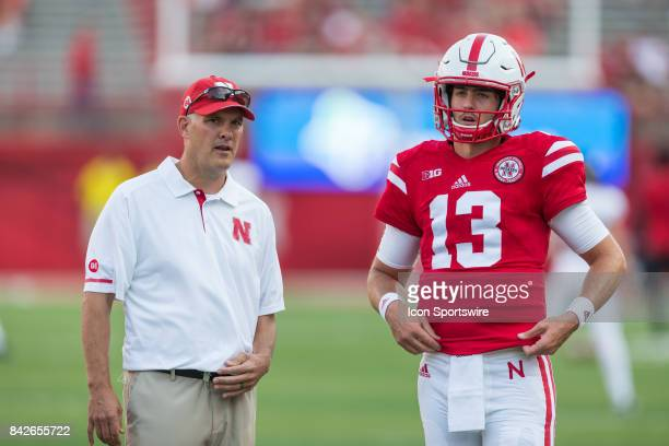 Nebraska offensive coordinator Danny Langsdorf with quarterback Tanner Lee during warmups before the game against the Arkansas State Red Wolves on...