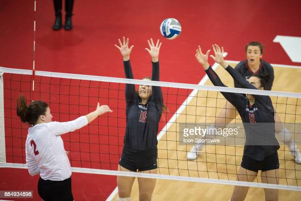 Nebraska outside hitter Mikaela Foecke spikes the ball past Washington State defensive specialist/libero Abby Phillips and Washington State middle...