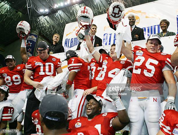Nebraska players celebrate after winning the 2005 MasterCard Alamo Bowl game game between the University of Michigan Wolverines and the University of...