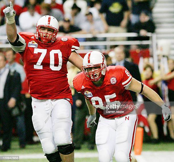 Nebraska players Matt Slauson and JB Phillips celebrate after a touchdown during the 2005 MasterCard Alamo Bowl game game between the University of...