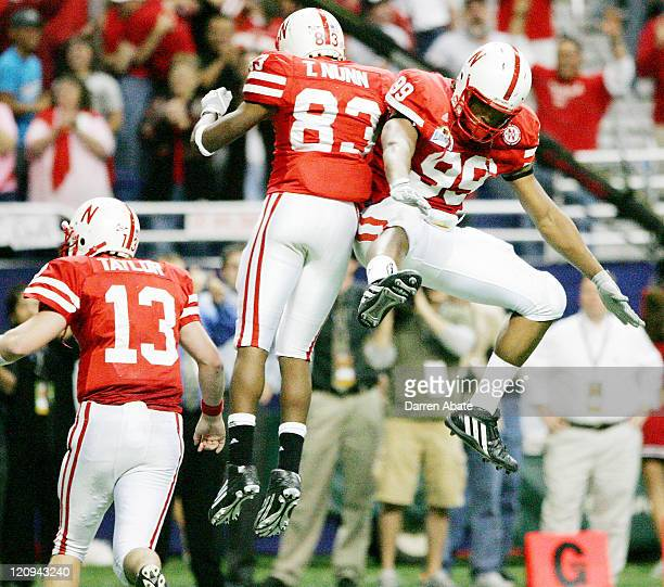 Nebraska players Terrence Nunn Barry Turner and Zac Taylor celebrate after a touchdown during the 2005 MasterCard Alamo Bowl game game between the...