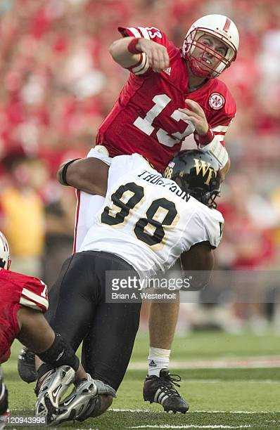 Nebraska QB Zac Taylor is hit by Wake Forest DE Jeremy Thompson just after releasing a pass during first quarter action at Memorial Stadium in...