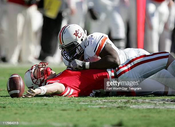 Nebraska quarterback Zac Taylor is sacked by Auburn's Pat Sims during the Cotton Bowl Classic in Dallas Texas Monday January 1 2007 The Tigers...