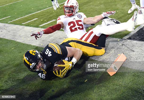 Nebraska safety Nathan Gerry can't prevent Iowa Hawkeyes tight end George Kittle from scoring during a Big Ten Conference football game between the...