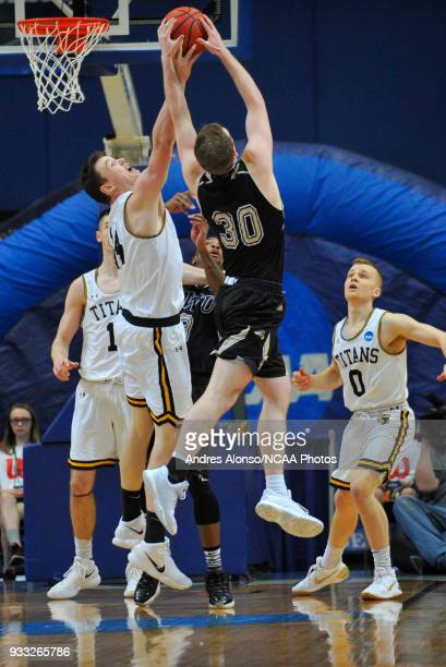 Nebraska Wesleyan Prairie Wolves forward Cooper Cook fights WisconsinOshkosh Titans Jack Flynn C for a rebound in the final minute of the Division...