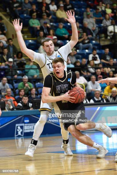 Nebraska Wesleyan Prairie Wolves forward Ryan Garver drives to the basket defended by WisconsinOshkosh Titans guard David Vlotho during the Division...
