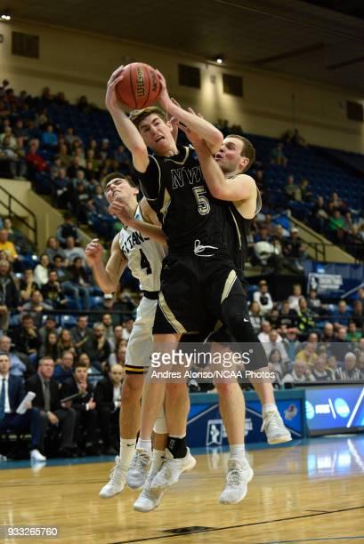 Nebraska Wesleyan Prairie Wolves guard Jack Hiller pulls down a rebound during the Division III Men's Basketball Championship held at the Salem Civic...