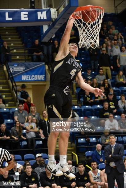 Nebraska Wesleyan Prairie Wolves guard Nate Bahe dunks for 2 points during the Division III Men's Basketball Championship held at the Salem Civic...