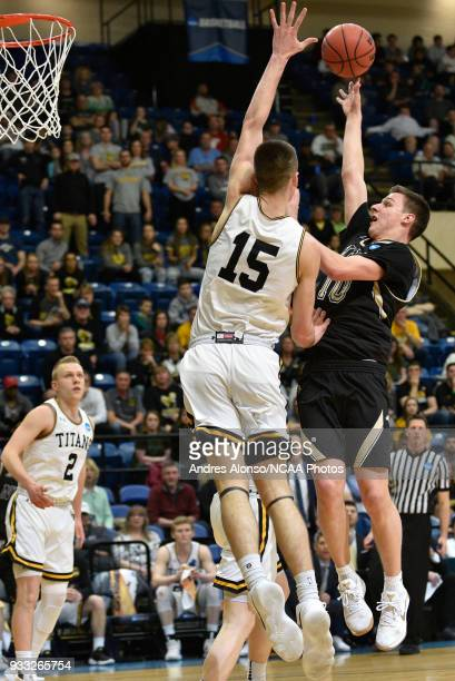 Nebraska Wesleyan Prairie Wolves guard Nate Schimonitz is defended by WisconsinOshkosh Titans forward Adam Fravert during the Division III Men's...