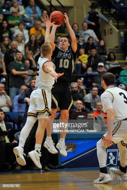 Nebraska Wesleyan Prairie Wolves guard Nate Schimonitz shoots a 3 point basket over WisconsinOshkosh Titans guard Ben Boots during the Division III...