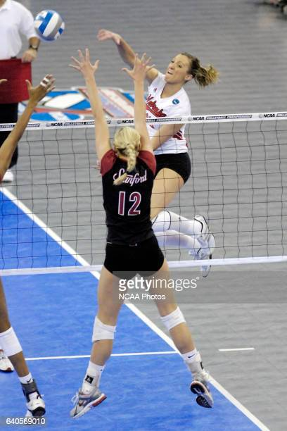 Nebraska's Jordan Larson hits the ball into the block of Stanford's Erin Waller during the 2006 Division I Women's Volleyball National Championship...