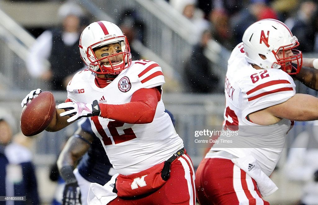 Nebraska's Ron Kellogg III drops back to pass against Penn State at Beaver Stadium in University Park, Pa., on Saturday, Nov. 23, 2013. Nebraska won, 23-20.