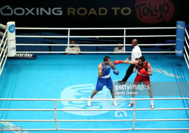 Necat Ekini of Turkey fights Gurgen Modoya of Armenia in their Men's Welter preliminary bout on Day Three of the Road to Tokyo European Boxing...