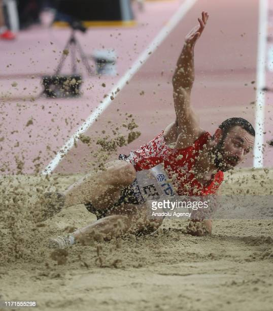Necati Er of Turkey competes in the Men's triple jump within the 17th edition of the IAAF World Athletics Championships at Khalifa International...