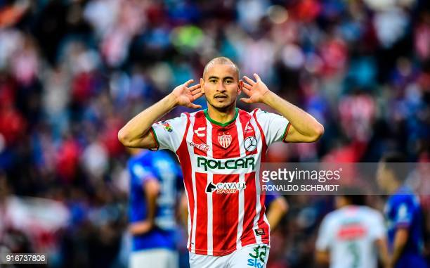 Necaxa's Carlos Gonzalez celebrates his goal against Cruz Azul during their Mexican Clausura 2018 tournament football match at the Azul stadium in...