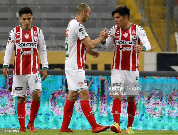 Necaxa's Martin Barragan celebrates with teammates after scoring a goal against Atlas during their Mexican Clausura 2018 tournament football match at...