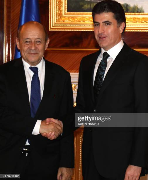 Nechirvan Barzani prime minister of Iraq's Kurdistan Regional Government shakes hands with French Foreign Minister JeanYves Le Drian on February 12...