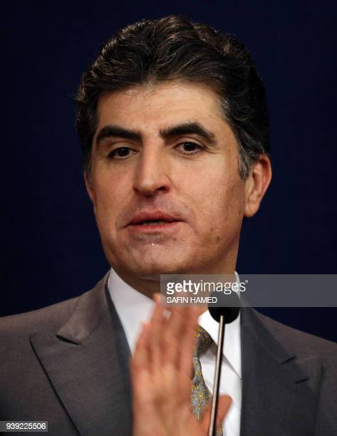 Nechirvan Barzani Prime Minister of Iraq's Kurdistan Regional Government speaks during a press conference in the northern Iraqi city of Arbil the...