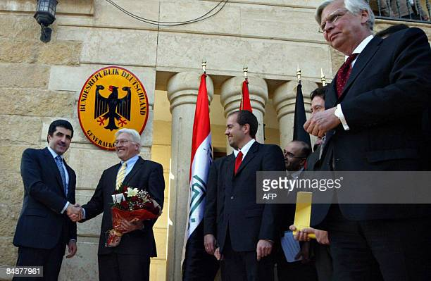 Nechirvan Barzani the prime minister of the Kurdish regional government shakes hands with FrankWalter Steinmeier Germany's foreign minister following...