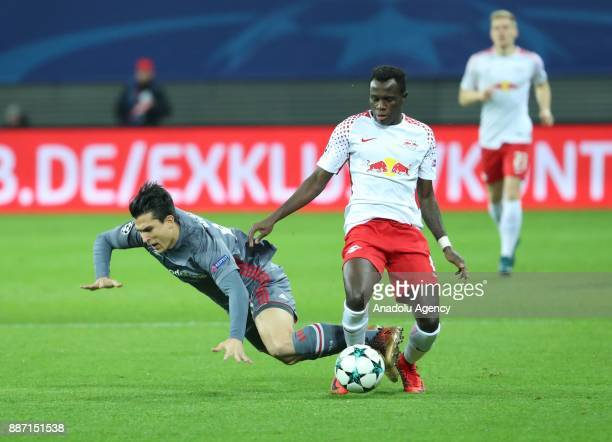 Necip Uysal of Besiktas in action against Bruma of Leipzig during UEFA Champions League group G match between RB Leipzig and Besiktas at Leipzig...