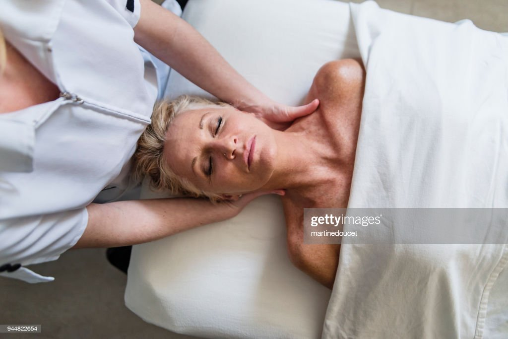 Neck massage to mature woman in beauty spa. : Stock Photo
