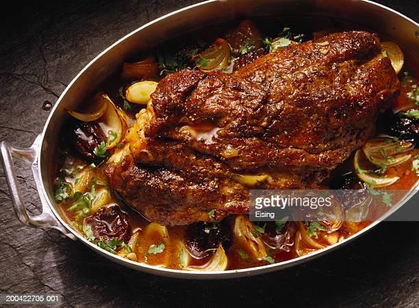 neck of pork with prunes - dörrpflaume stock-fotos und bilder