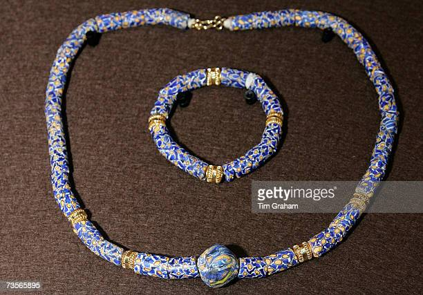 A necklace and bracelet gift given to Queen Elizabeth II during a visit to Ghana on display in the Royal Collection in the Picture Gallery at...