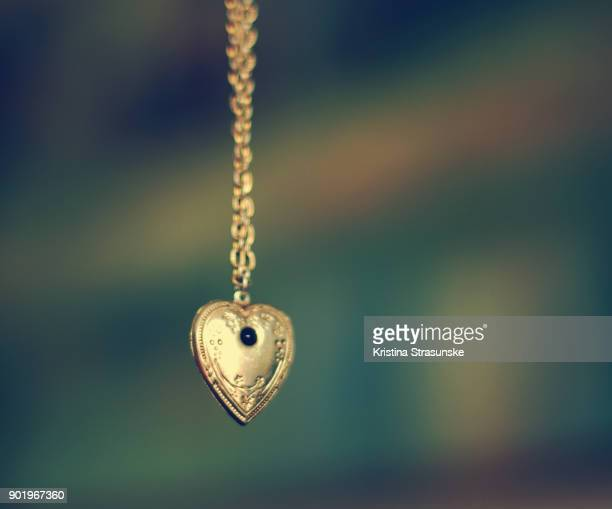 necklace with heart pendant - pendant stock pictures, royalty-free photos & images