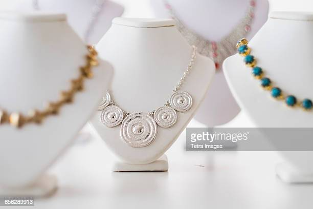 necklaces on display - jewelry store stock pictures, royalty-free photos & images