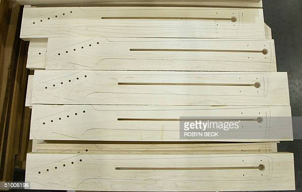 Necks are traced onto wood to be cut for Fender Stratocaster guitars at the Fender manufacturing facility in Corona California 28 June 2004 The...