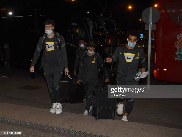 Neco William, Alex Oxlade-Chamberlain and Mohamed Salah of Liverpool arriving before the UEFA Champions League group B match between Atletico Madrid...