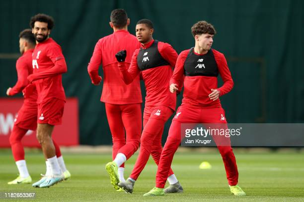 Neco Williams and Rhian Brewster warm up during a Liverpool training session ahead of the Champions League group E match against KRC Genk at Melwood...