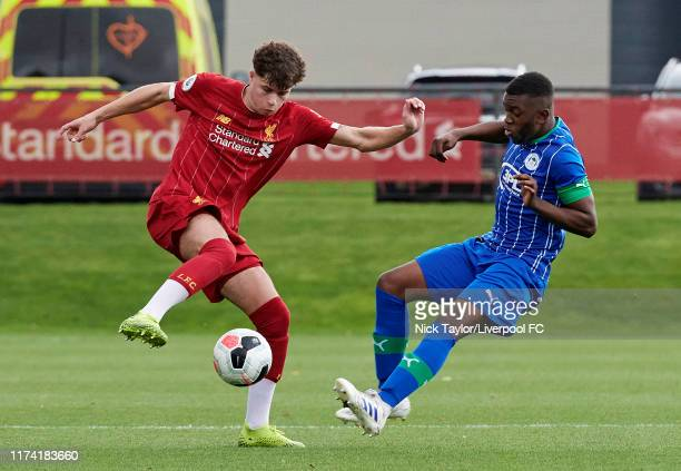 Neco Williams of Liverpool and Divin Baningime of Wigan Athletic in action during the Premier League Cup game at The Kirkby Academy on October 6 2019...
